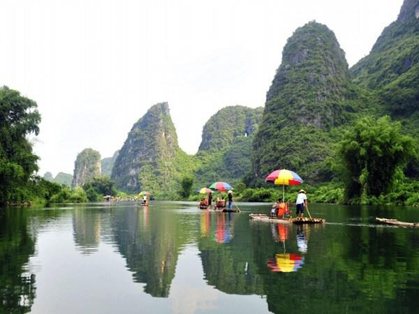 Image result for bamboo rafting in Li River  images