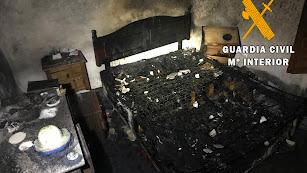 Estado en que quedó la habitación incendiada de la vivienda