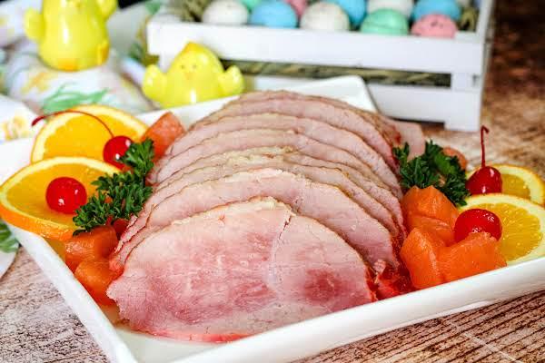 Slices Of Easter Ham On A Platter.