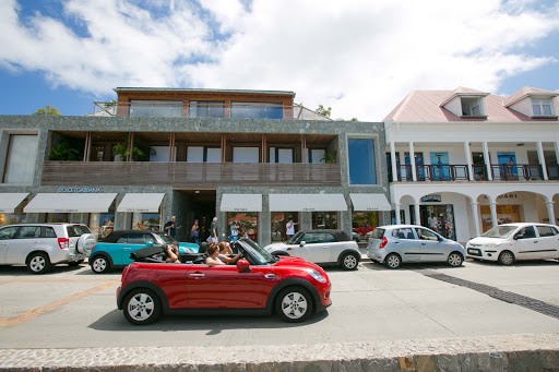 gustavia-promenade.jpg - A roadster passes by designer stores along the promenade in Gustavia.