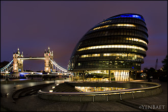 Photo: Tower Bridge and City Hall - London,UK.  A familiar view of London's popular landmarks on an unusually quiet night.  ... The City hall designed by famed London architect Norman Foster was opened in July 2002. It sits on the south bank of the river Thames near another popular landmark, the Tower bridge. The rounded, bulb-shaped city hall was designed to be environmentally friendly, and even includes solar panels. The unusual building has been likened to many things including Darth Vader's helmet, a misshapen egg, a woodlouse and a motorcycle helmet.  #London   #England   #UK   #TowerBridge   #Travel   #Photography