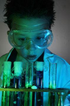 Little boy working in science lab