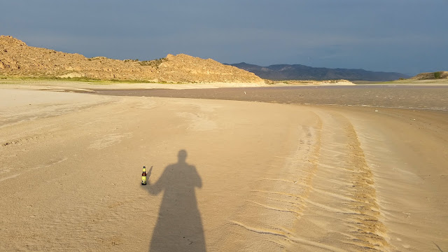 Shadow selfie with a beer on the beach