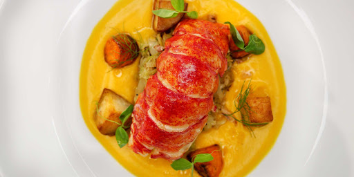Luminae-Buttered-Lobster.jpg -  A buttered lobster at Luminae, the upscale restaurant available to suite passengers on Celebrity Edge.