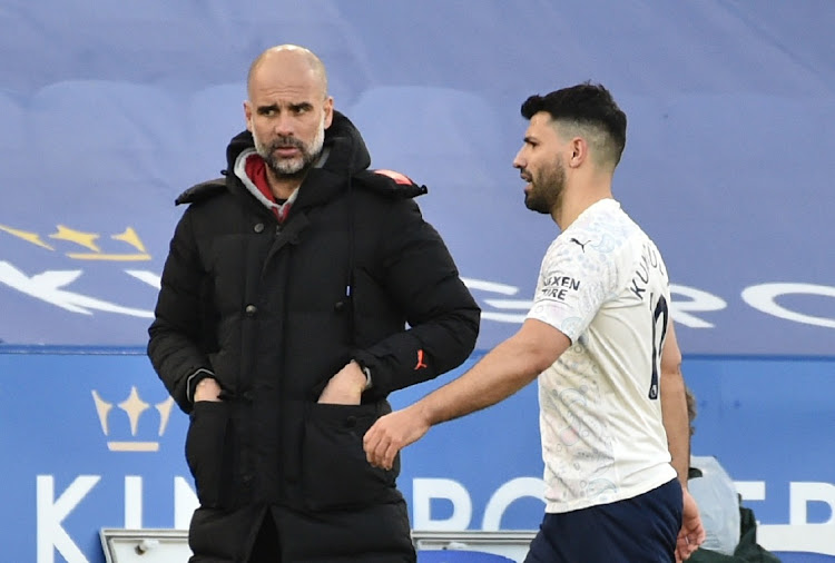 Manchester City's Sergio Aguero with manager Pep Guardiola after being substituted in the Premier League match against Leicester City at King Power Stadium, Leicester on April 3, 2021