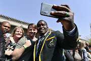 Springbok player Trevor Nyakane meet fans during the South African national men's rugby team official send-off at OR Tambo International Airport on August 30, 2019 in Johannesburg, South Africa.