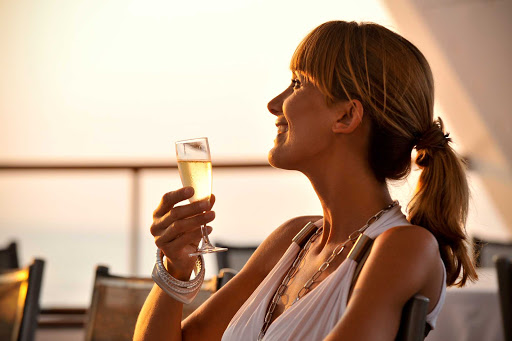 Ponant-champagne.jpg - Sunset and a perfectly chilled glass of champagne make for a perfect vacation escape on a Ponant cruise.