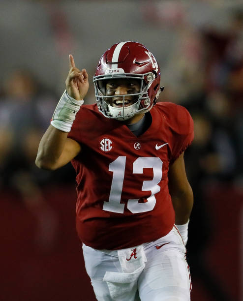 Tua Tagovailoa of the Alabama Crimson Tide reacts after passing for a touchdown to DeVonta Smith against the Auburn Tigers at BryantDenny Stadium on...