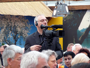 Photo: Special CP-exhibition at the Regio-Messe 2010. Siggi Hartmeyer filming the opening show with trade-fair director Uwe Claassen and many prominent speakers and guests.