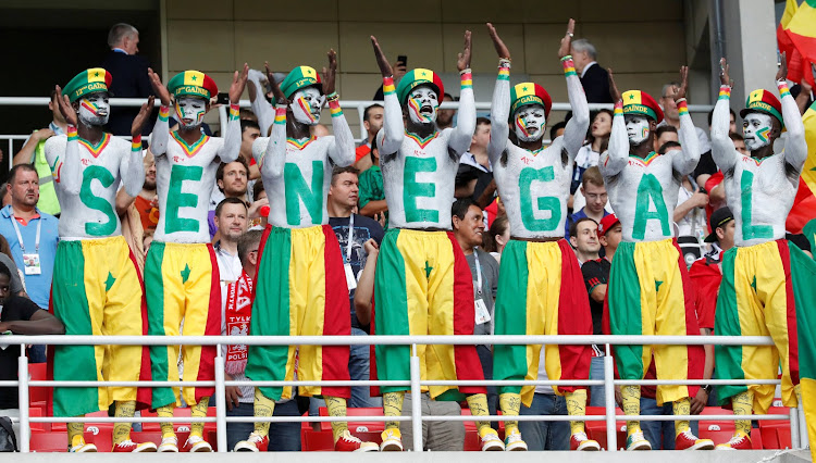 Senegal's fans cheer in the stadium during the match.