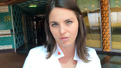 Erin-Duffey.jpg - The super-nice Erin Duffey, Westerdam's cruise director, gave high marks to the JoCo crowd.