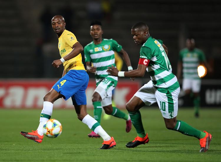 Tebogo Langerman of Mamelodi Sundowns (R) tries to stop Bloemfontein Celtic's captain and goalscorer Ndumiso Mabena.