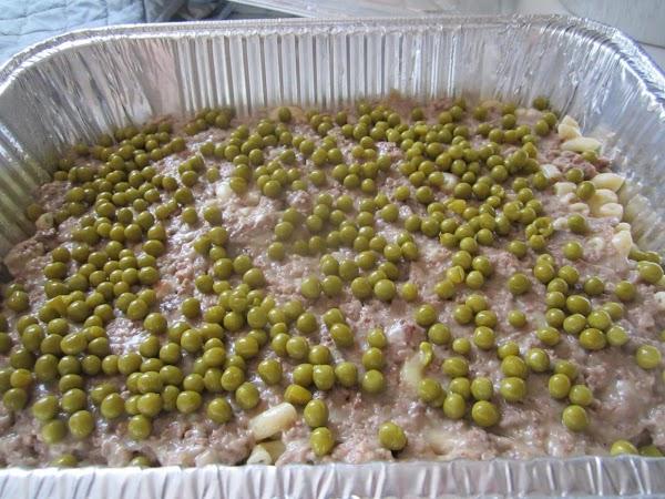 Next sprinkle 1/2 of baby peas over mixture