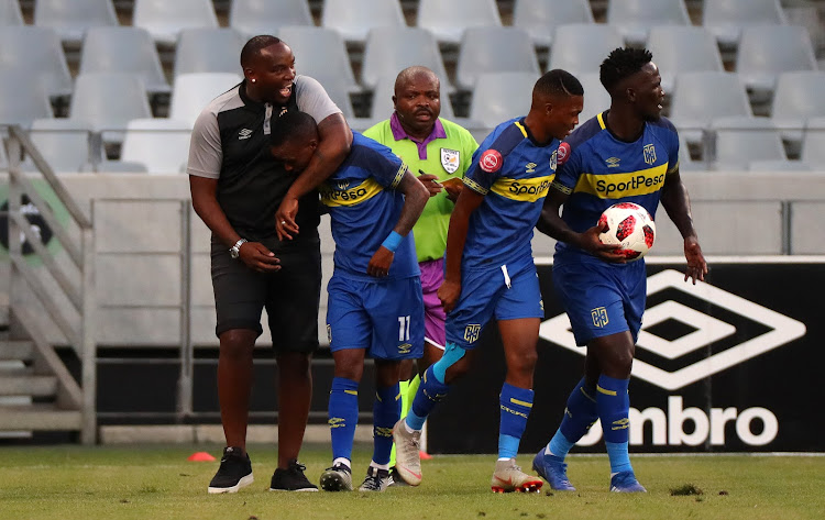 Cape Town City FC head coach Benni McCarthy hugs goal scorer Surprise Ralani during a come-from-behind 3-2 Absa Premiership win over Bloemfontein Celtic at Cape Town Stadium on Saturday December 22 2018.