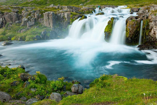Dynjandi is a series of waterfalls in the Westfjords, Iceland, near the Fosshotel. See it on a Windstar cruise.