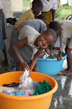 Photo: Mariam washing her clothes