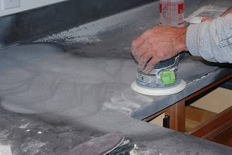Photo: Buffing out the seam between two Corian slabs.