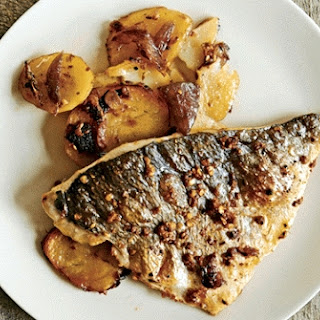 Masala Grilled Fish On A Bed Of Potatoes.