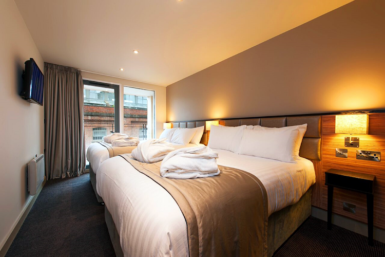 Superior bedroom in La Reserve Aparthotel Manchester