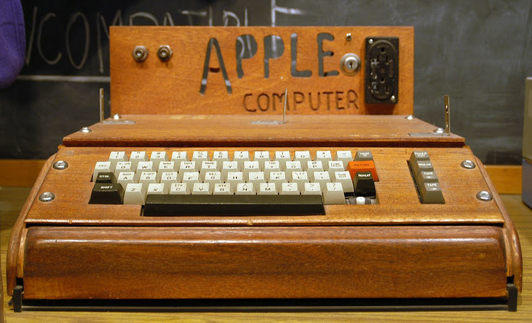 A fully assembled Apple I computer with a homemade wooden computer case. Picture: WIKIPEDIA