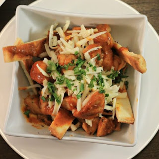 Butter Chicken Poutine with Naan Bread Fries.