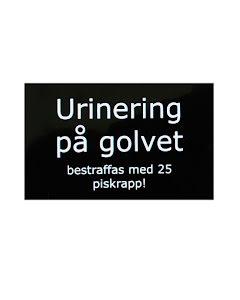 Skylt, urinering på golvet bestraffas med 25 piskrapp!