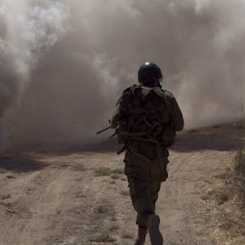 A soldier ran through thick smoke by Yeshaya Dinerstein - People Professional People ( shooting, american, danger, troops, view, commando, sniper, action, military, active, tactical, water, adventure, army, person, background, israeli, silhouette, force, rifle, assault, gun, woman, warrior, tourism, combat, training, infantry, summer, uniform, weapon, security, world, attack, man, park, fight, ammunition, nature, war, people, lifestyle, outdoor, battle, special, marines, soldier, battlefield, israel, armed )