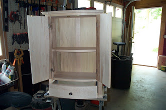 Photo: Inside the curved front wall cabinet