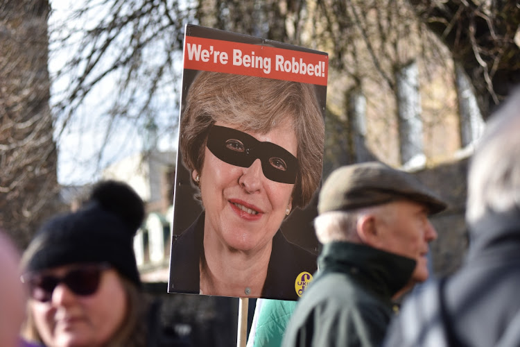 An anti-Brexit placard shows an image of British Prime Minister Theresa May outside parliament in London, March 14 2019. Picture: JOHN KEEBLE/GETTY IMAGES