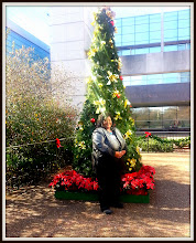 Photo: Me in front of the Christmas tree at work