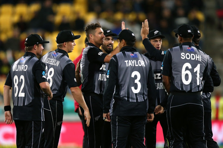 Tim Southee of New Zealand celebrates with teammates after taking the wicket of Rohit Sharma of India during game one of the International T20 Series between the New Zealand Black Caps and India at Westpac Stadium on February 06, 2019 in Wellington, New Zealand. Picture: GETTY IMAGES/HAGEN HOPKINS