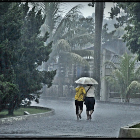 Two ladies with one umbrella by Achmad Bachtiar - People Street & Candids ( labor, bogor, ladies, indonesia, rain )