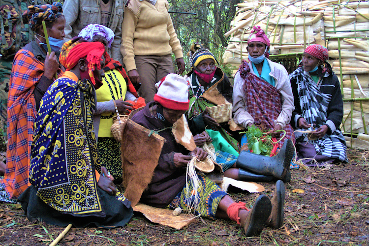 Women from the Ogiek community display their skills