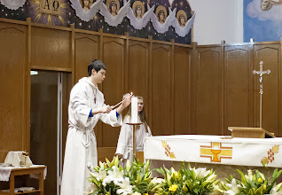 Photo: March 30th, 2013 - Guardian Angels church, Vancouver BC An altar boy lights the candle for the Easter Mass Service ceremony. Copyright Adrian Geronimo