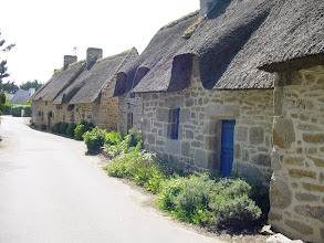"Photo: On our short drive back, we stop in the small villages of Kercanic and Kerambris, which we chanced on earlier, courtesy of Mme. La Carte. The homes have the traditional rye straw roof thatching, and the ""Breton blue"" doors."