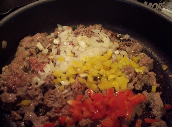 Add diced onion & peppers and saute until softened.