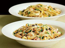Put pasta on platter garnish with capers, lemon curls, parsley and a drizzle of...