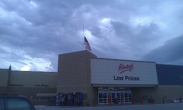 Photo: I took a rare opportunity to go shopping alone to kickstart our oral care drive. I headed to our Walmart and noticed they had the flag at half mast. I assume this is for the recent tragedy in the theater shootings in Colorado.  Also, see that storm brewing?!!