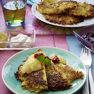Potato Pancakes with Apple Compote, Cranberry Sauce and Cinnamon Cream.