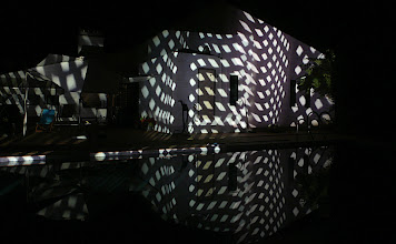 Photo: Projection of slides, 3 projectors, mirrored in the swimming pool.