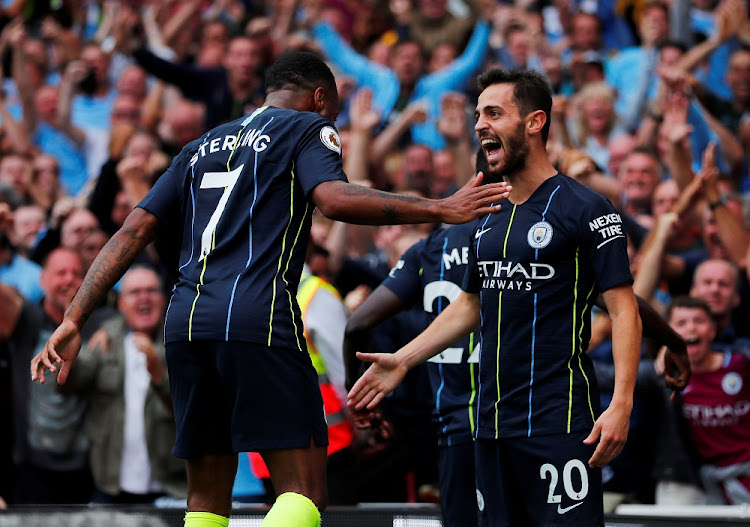 Manchester City's Bernardo Silva celebrates scoring their second goal with Raheem Sterling against Arsenal in London, Britain, August 12 2018. Picture: REUTERS/EDDIE KEOGH