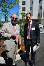 Photo: Roger Hinshaw of Bank of America Merrill Lynch and REACH CEO Dan Valliere