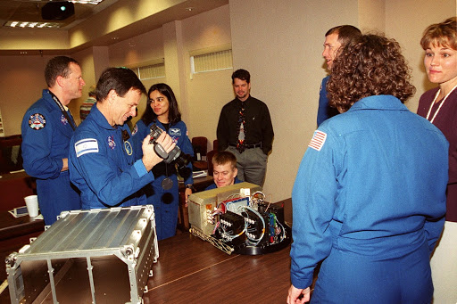 Members of the STS-107 crew check out one of the Biotube experiments that will be part of their research mission.