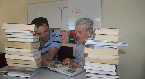 Heads down and poring over the books to set the Rotary Trivia Night questions, Narrabri Rotarians Darrell Tiemens and Ralph Schulze plan to test participants' general knowledge.