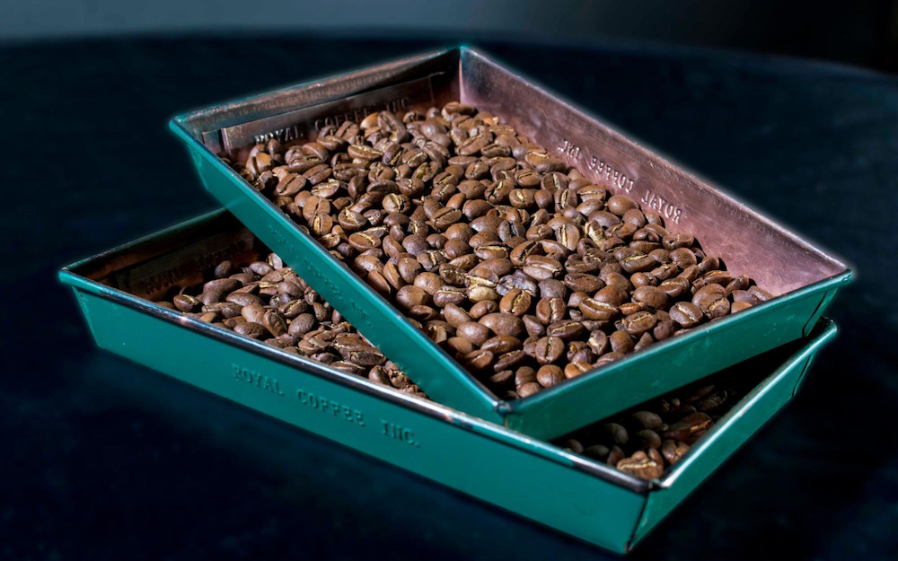 tray of roasted coffee beans