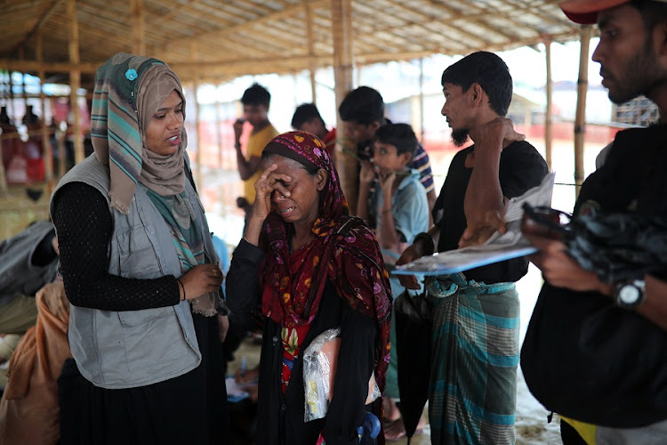 Jamila Khatu, a Rohingya refugee, breaks into tears as she speaks of her son in Malaysia whom has been missing for eight years. Kutupalong camp in Cox's Bazar, Bangladesh on July 4 2018 Picture: REUTERS/MOHAMMAD PONIR HOSSAIN