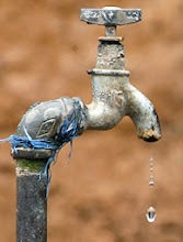 Photo: A drop of water drips down from a tap at a farm house in the outskirts of Shanquan township, in China's southwestern province of Sichuan, 25 March 2007. A drought in southwestern China has left 5.5 million people short of drinking water and resulted in millions of dollars in damages. Lack of rainfall and unusually warm temperatures are to blame for the drought that has hit farmers in Sichuan province, causing losses of nearly 300 million yuan (38 million USD), the official Xinhua news agency said.   AFP PHOTO/LIU Jin