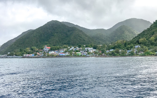 An early morning mist shrouds the western coastline of Dominica.