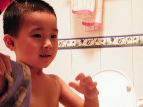 Photo: baby prepared to finish bath.