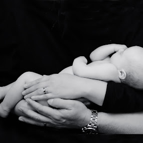 Holding love in our arms by John & Sharon Green - Babies & Children Babies ( love, babies, black and white, arms, newborn )